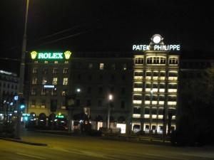 Leuchtreklame von Patek Philippe und Rolex in Genf
